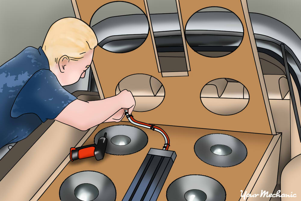 person installing a sub woofer