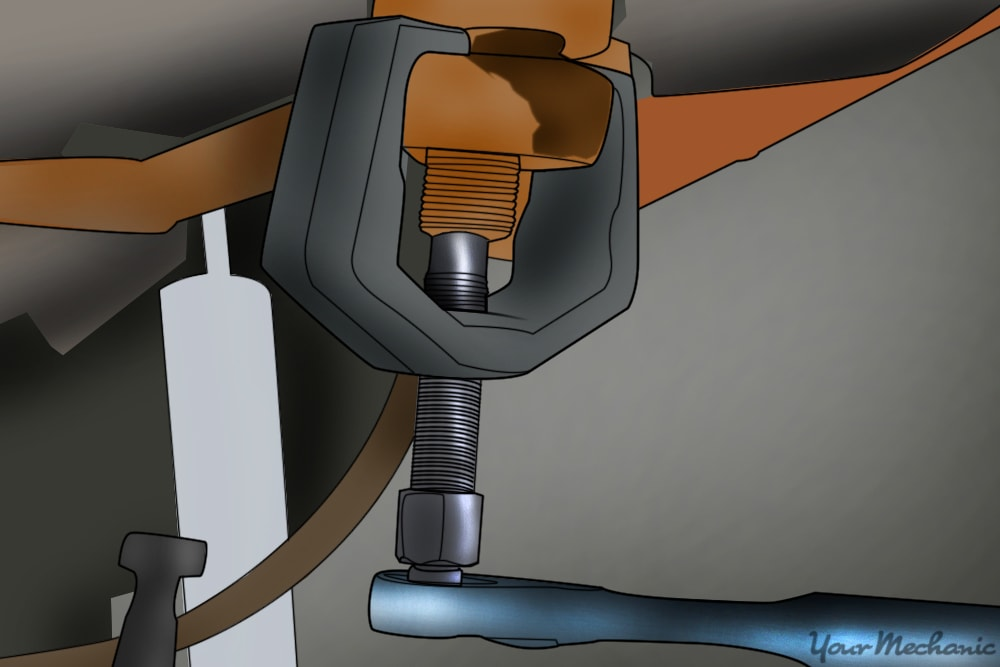 pitman arm removal tool being used to remove pitman arm