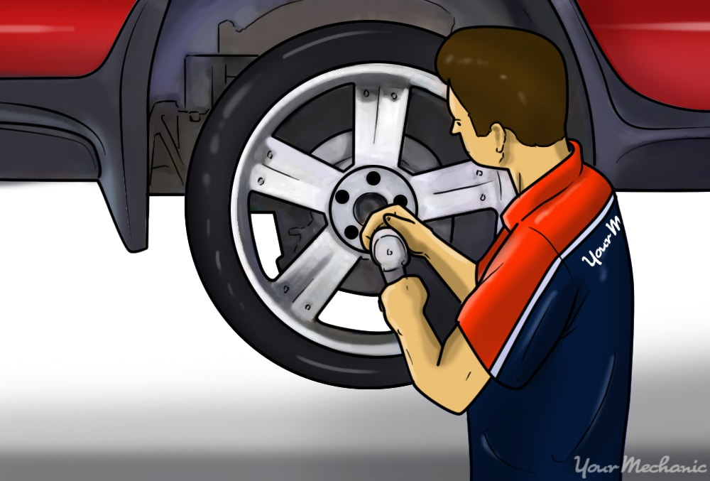 installing wheels back onto vehicle