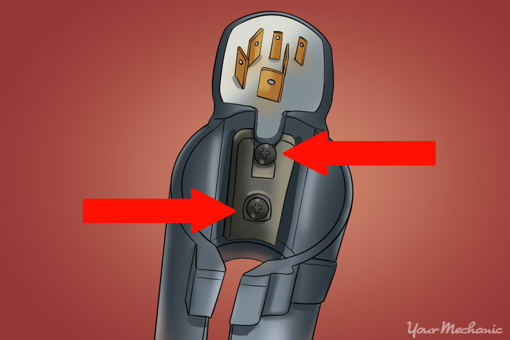 location of the two screws on top of the ignition lock body