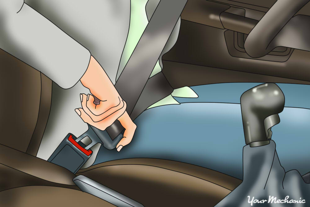 person pulling seatbelt towards buckle