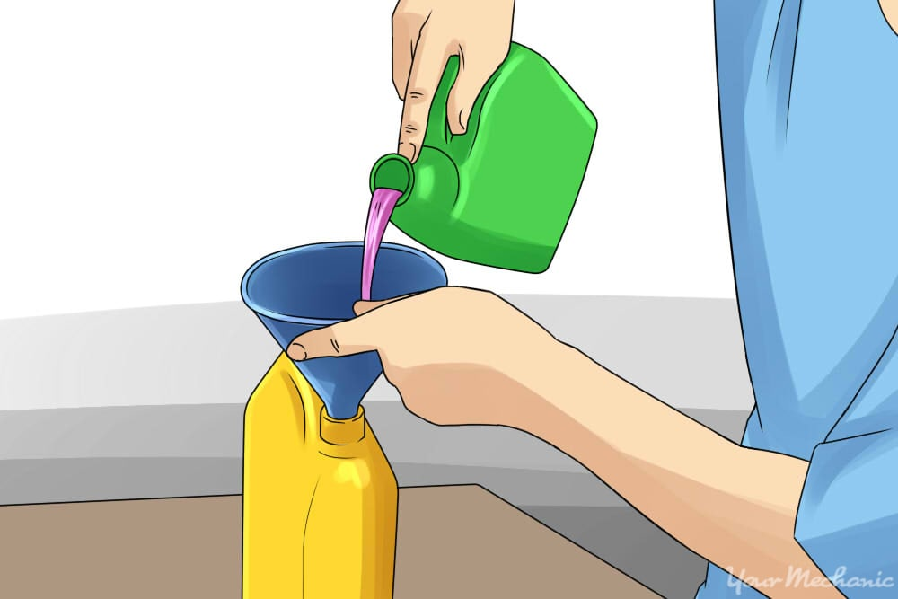 person pouring coolant into another canister