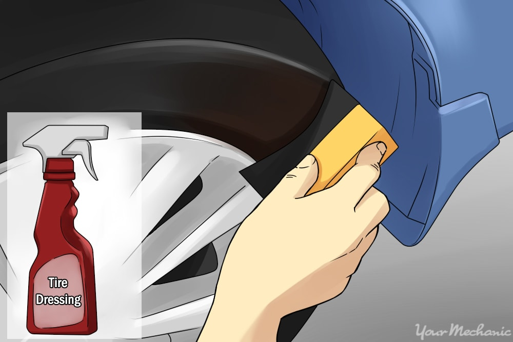 person applying tire dressing to applicator pad