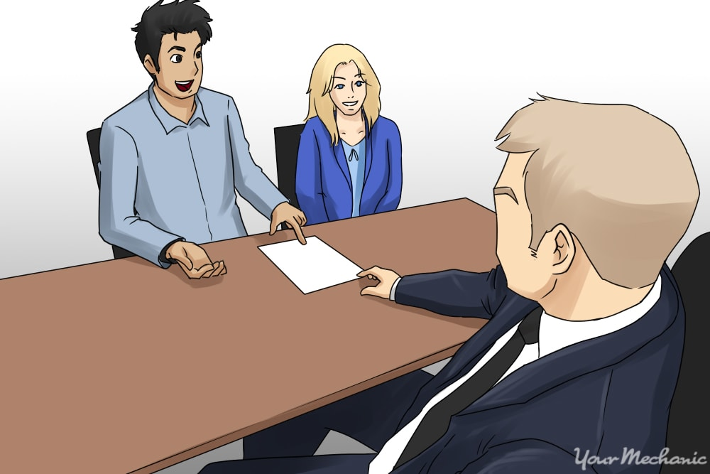 couple negotiating with salesman