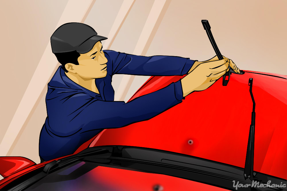 man installing new wiper blades onto arms