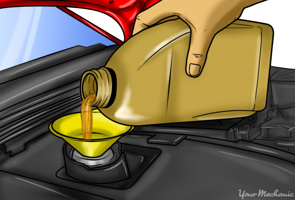 pouring quart of oil into funnel