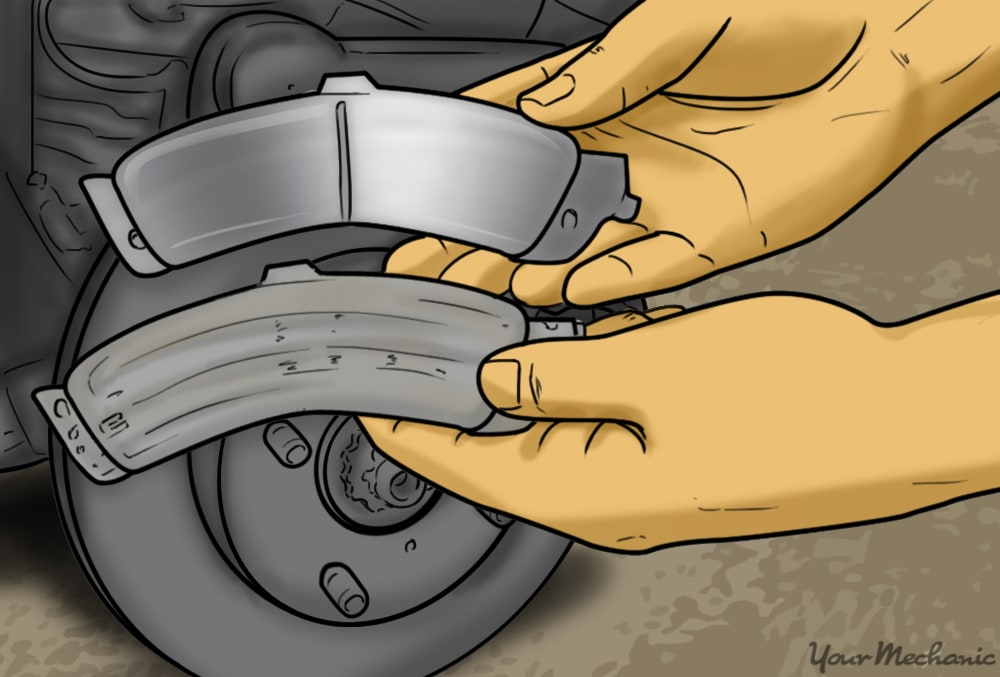 hands holding new brake pads