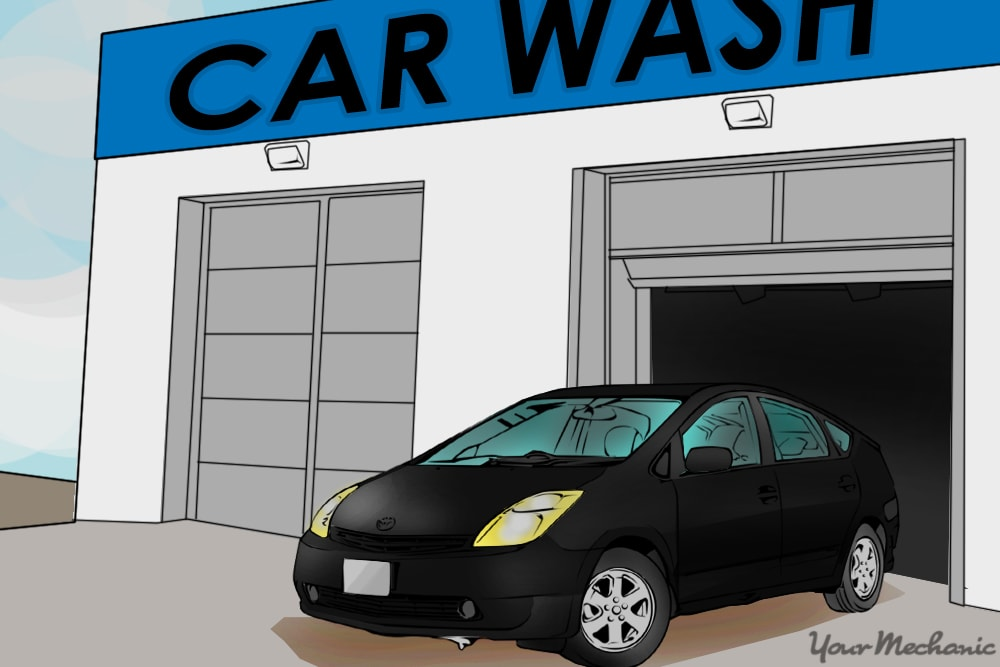 car pulling out of a car wash bay