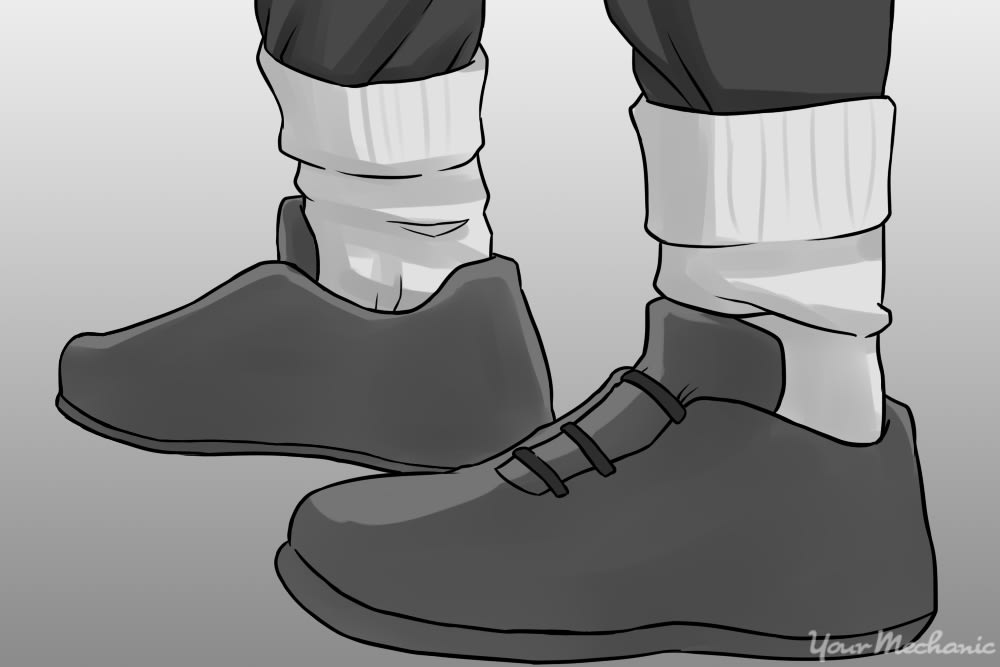 p3rson tucking in th3ir pants into socks