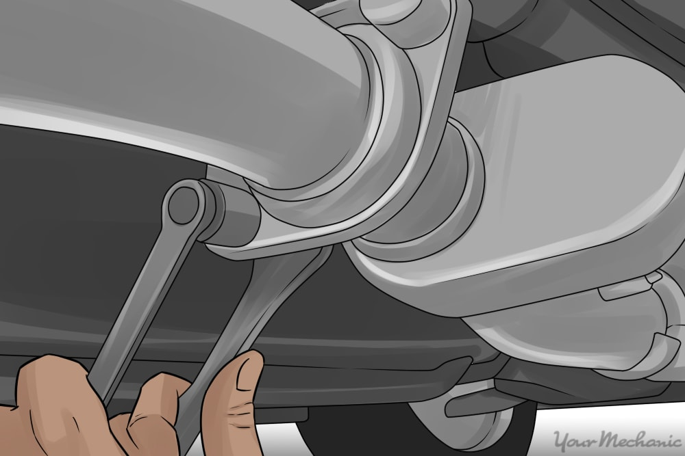 person removing bolts from an exhaust clamp