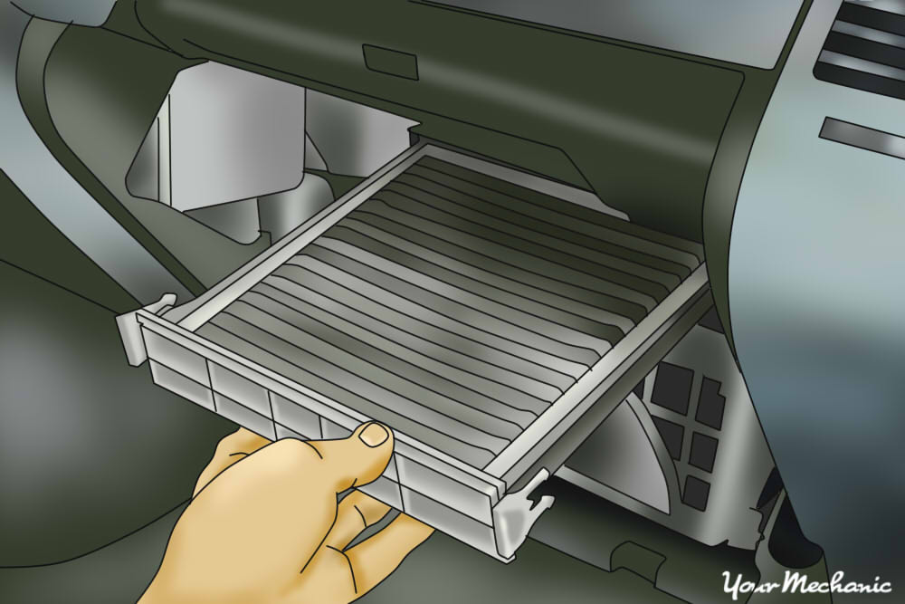 cabin filter being pulled out