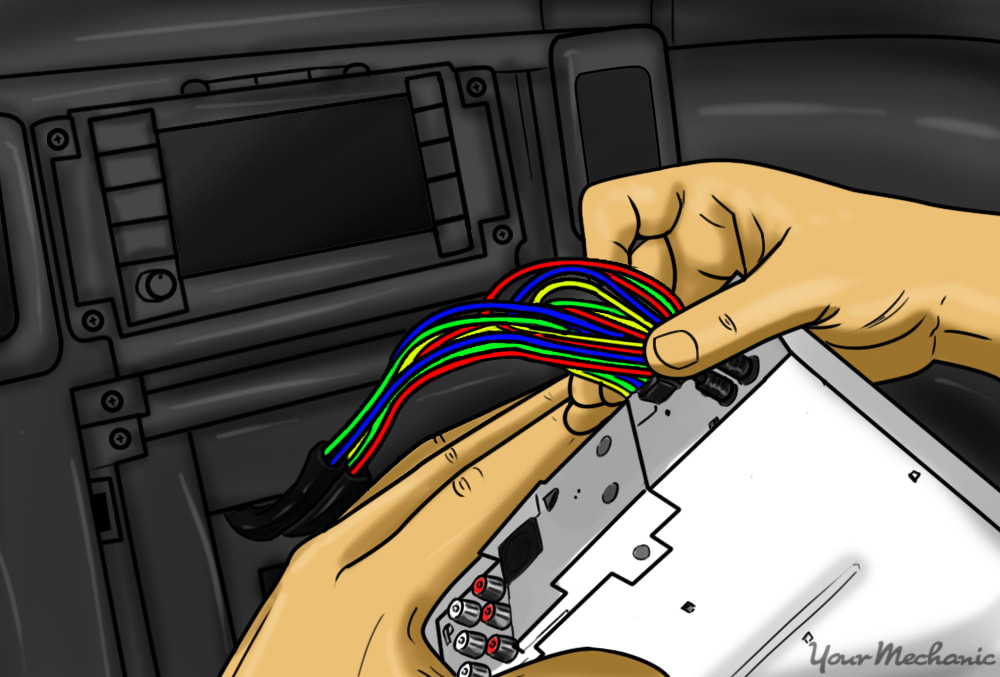 person connecting stereo harness to the rear of the new stereo