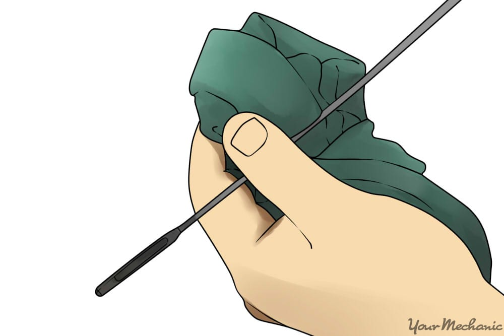 man holding dipstick at acceptable levl