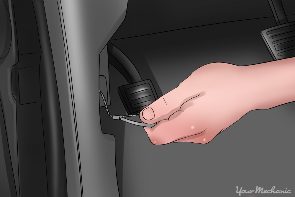 hand reaching for hood release lever cable
