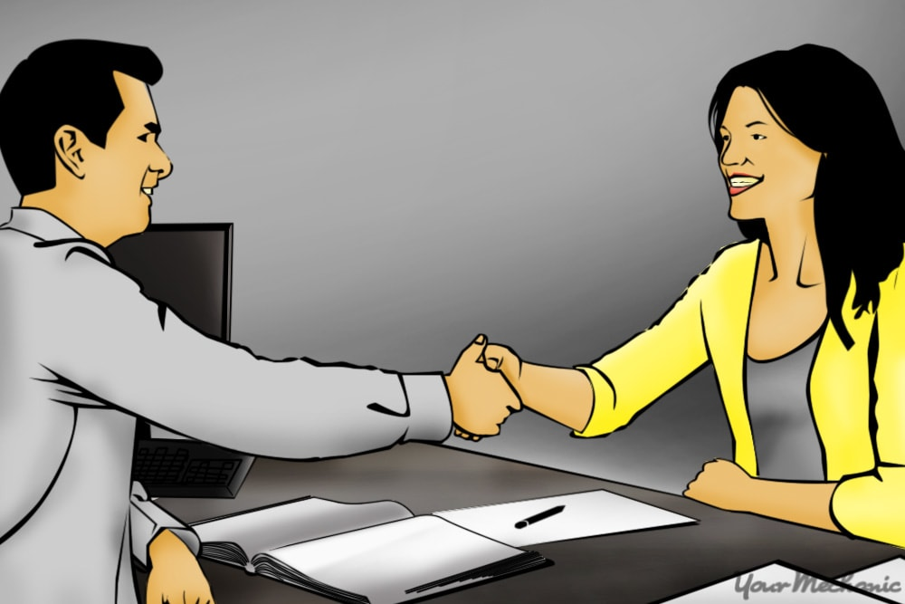 salesman and customer shaking hands