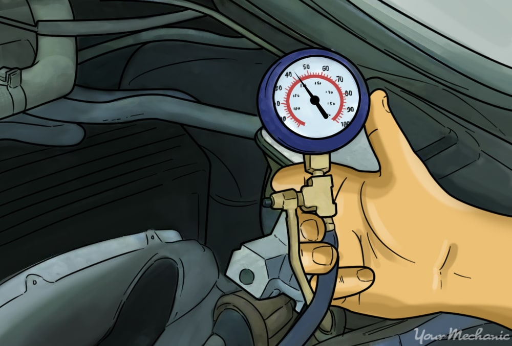 hand holding a pressure tester attached to an engine showing pressure