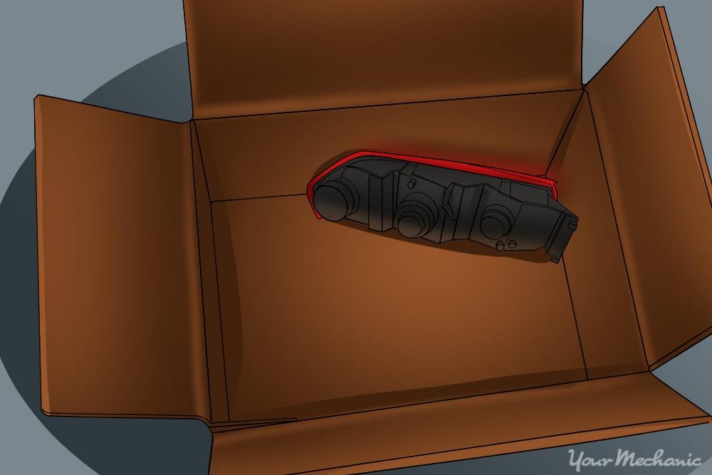 light housing in a cardboard box