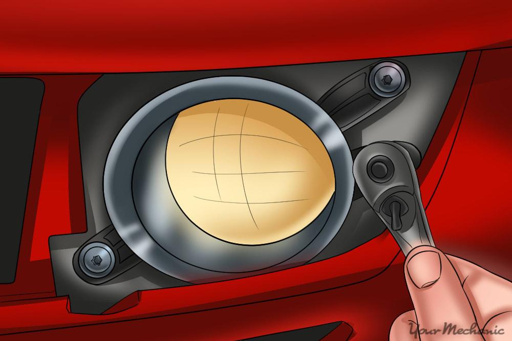 driving light bezel being reinstalled by a mechanic