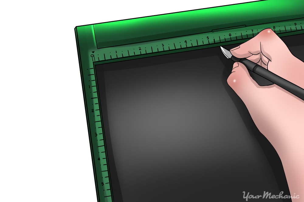 window film being cut along scored edge