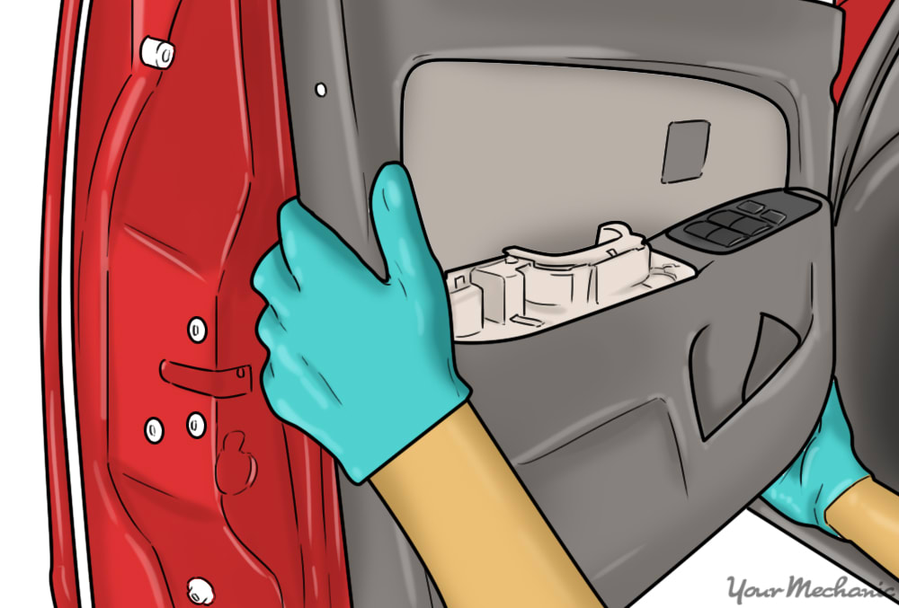 hands lifting panel off of inside of car door