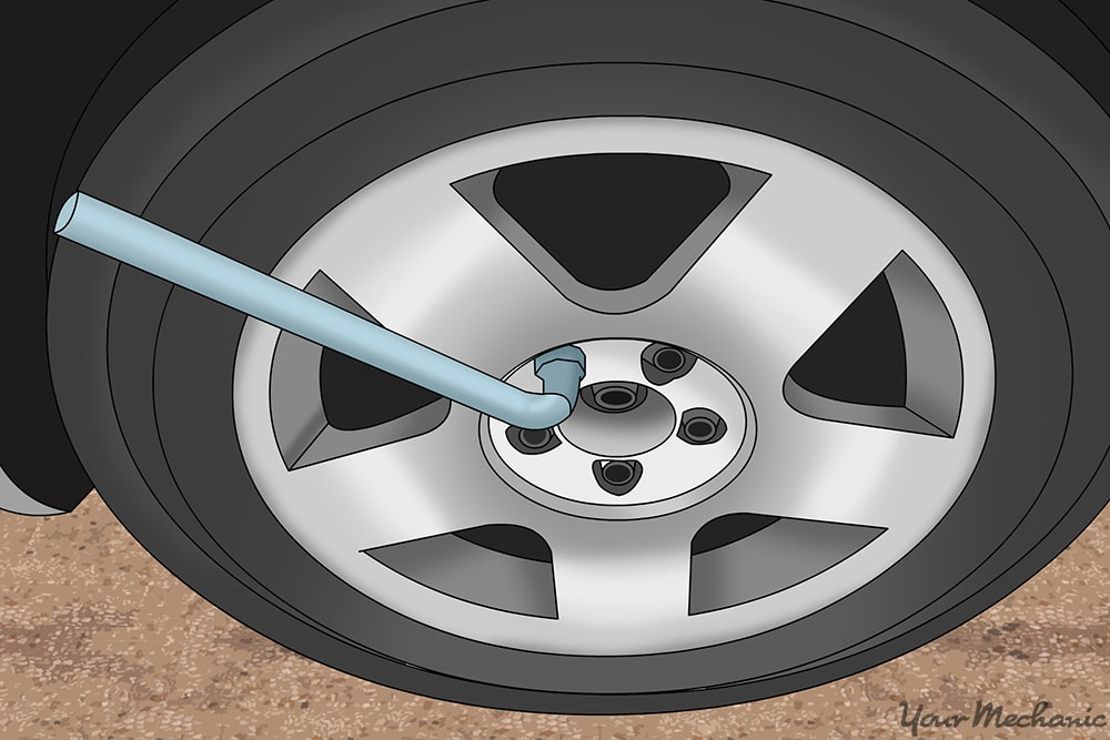 lug wrench attached to one of the lug nuts