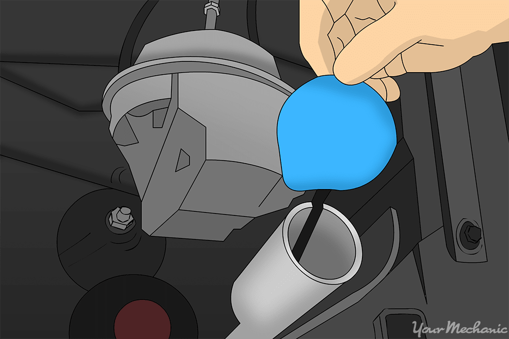 hand holding cap to washer reservoir