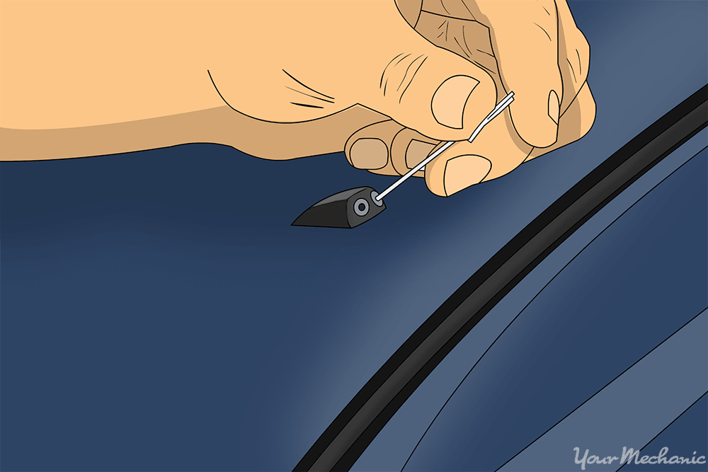 hand inserting sewing needle to unclog it