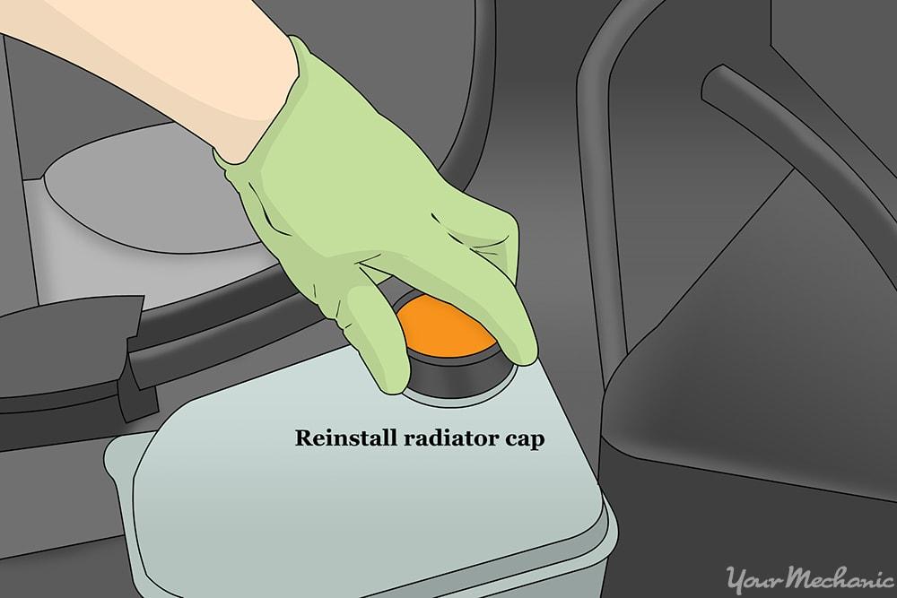 person wearing gloves reinstalling the radiator cap
