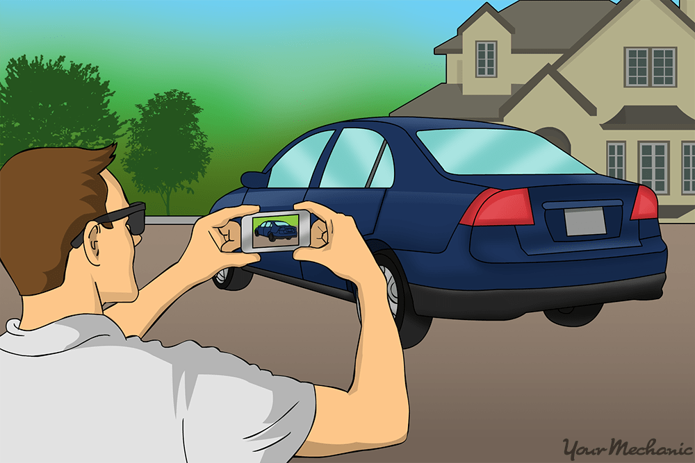 person taking pictures of car before it