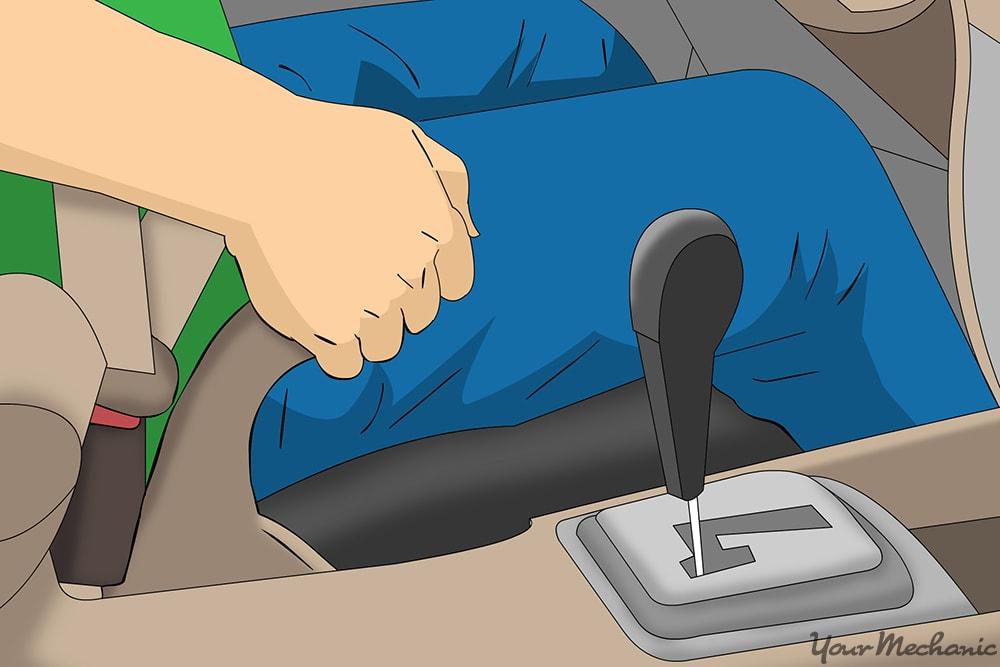 person engaging parking brake