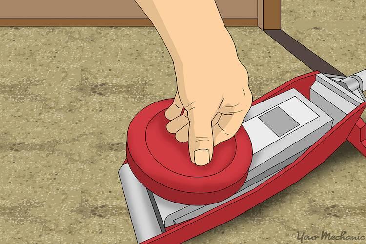 hand testing floor jack mechanism