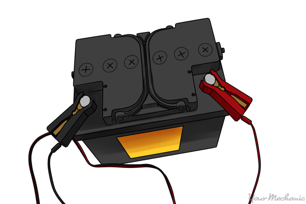battery with positive and negative clamps attached
