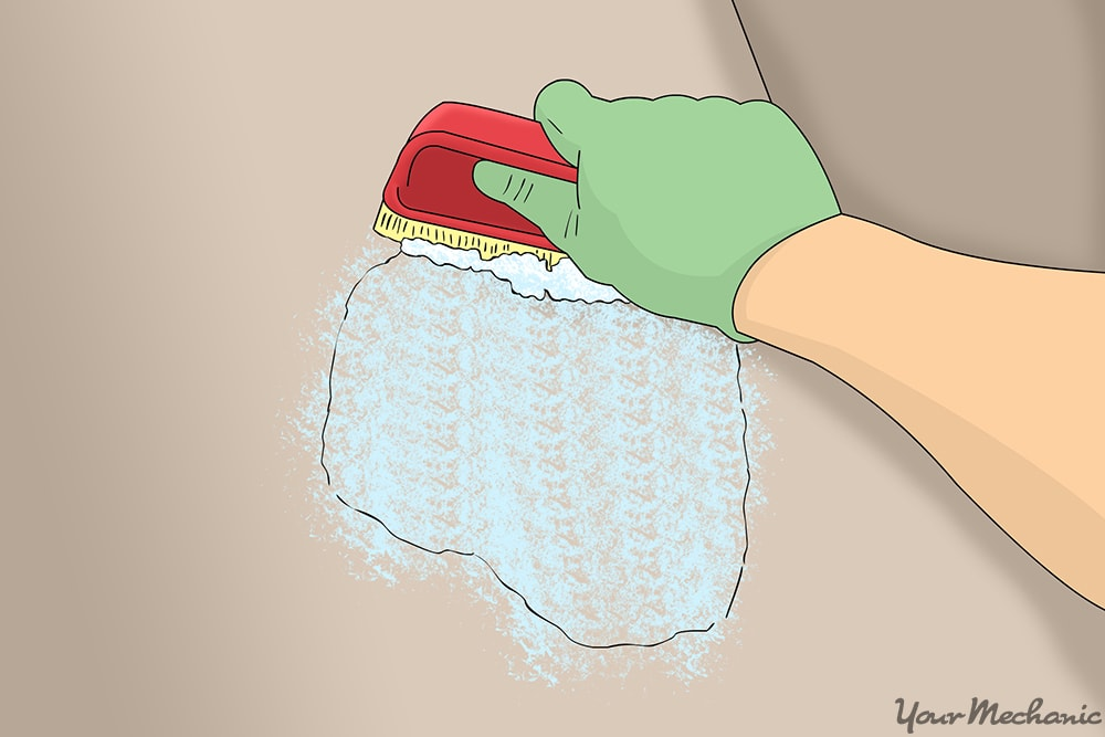 scrub brushing carpet