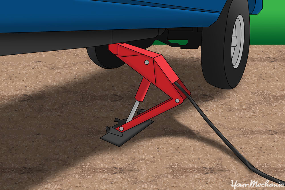 using a jack to raise a vehicle