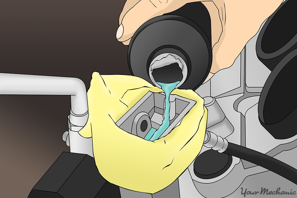 brake fluid being poured into the reservoir