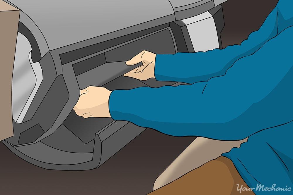 person removing the glove box