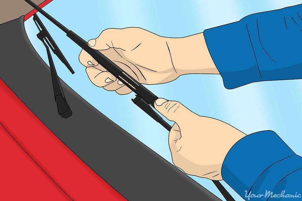 hands replacing wiper blades