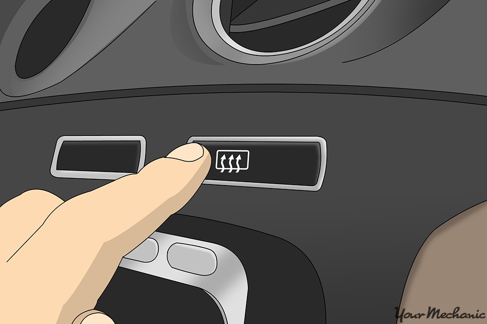 close up of finger pressing he defroster button