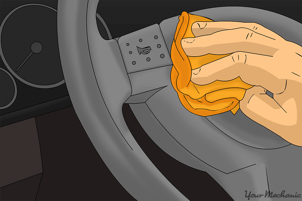close up of hand cleaning steering wheel