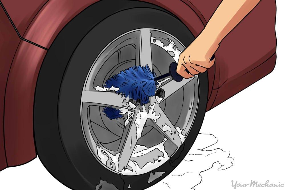 washing wheels with brush