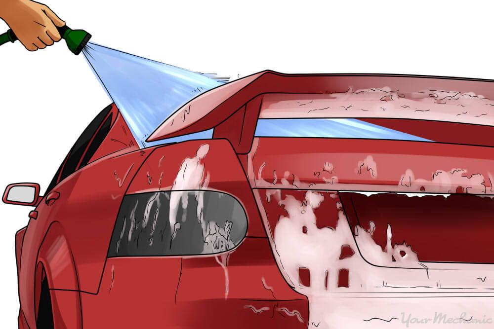 rinsing off a car