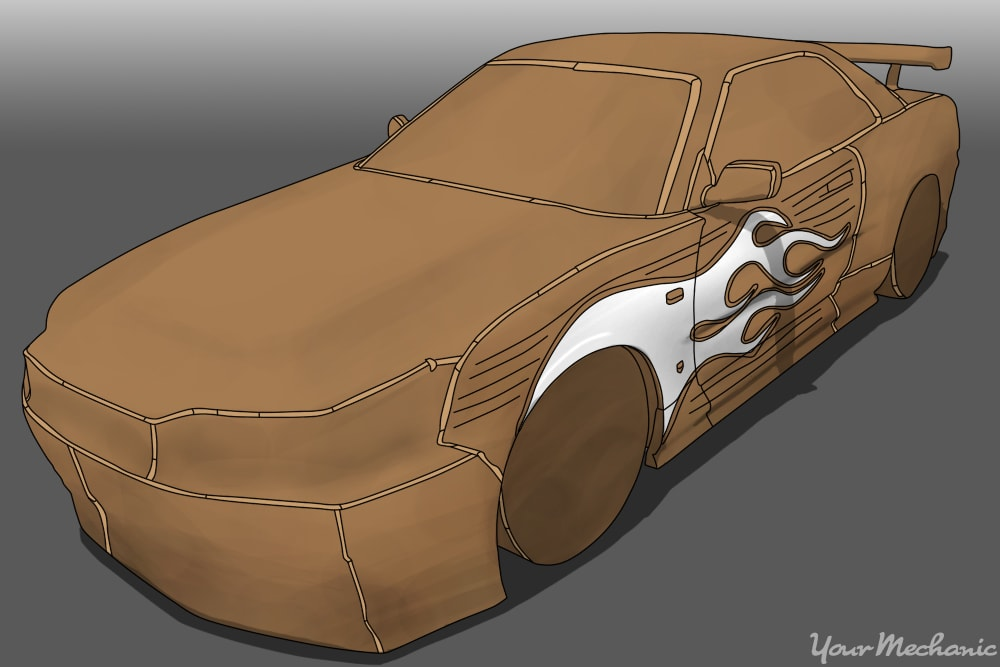 car ready for paint with plastic covering