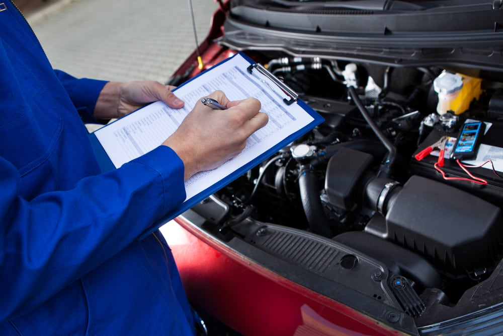 Technician performing vehicle inspection