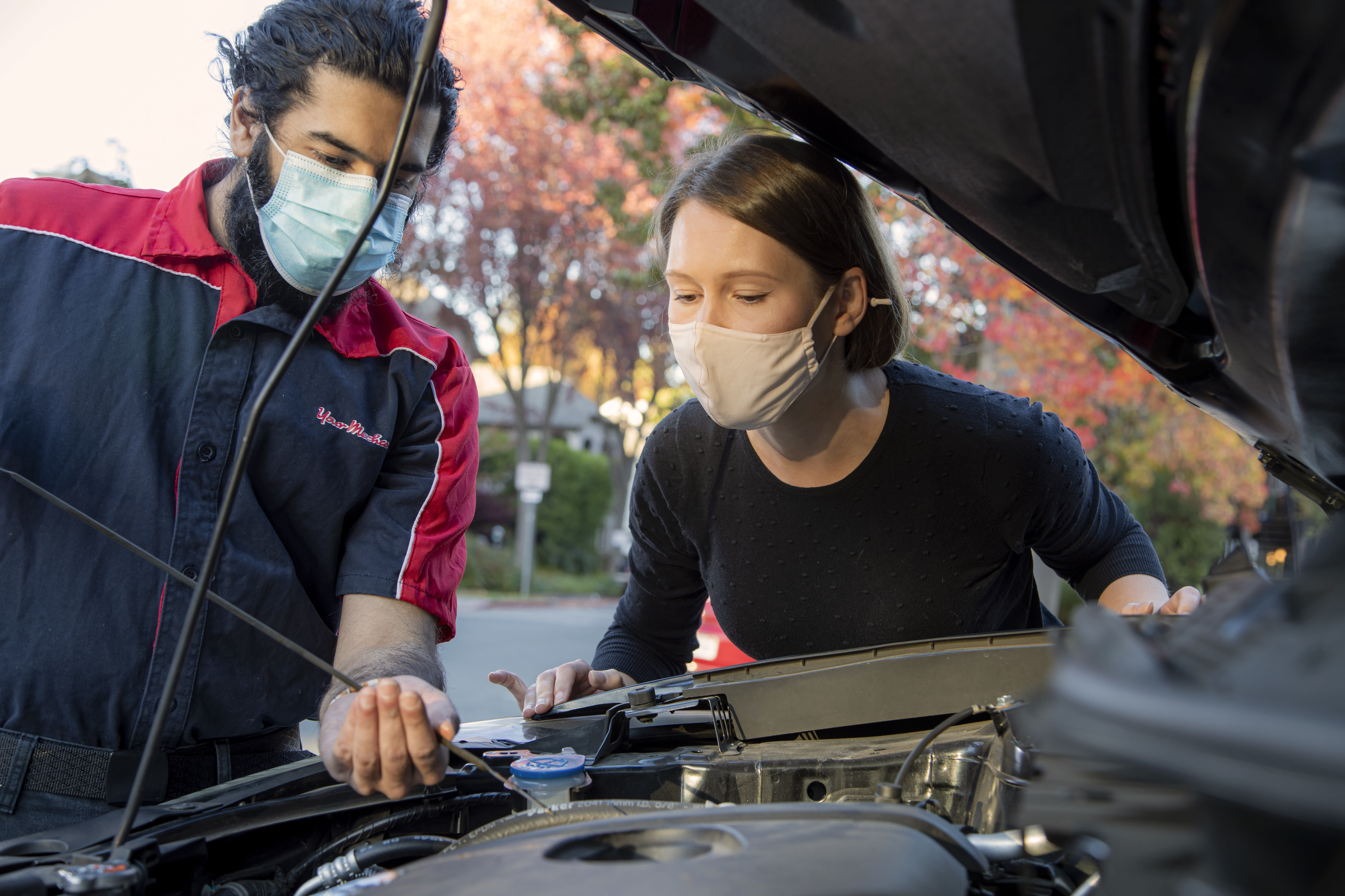 Mobile mechanic repairing a car at a customer