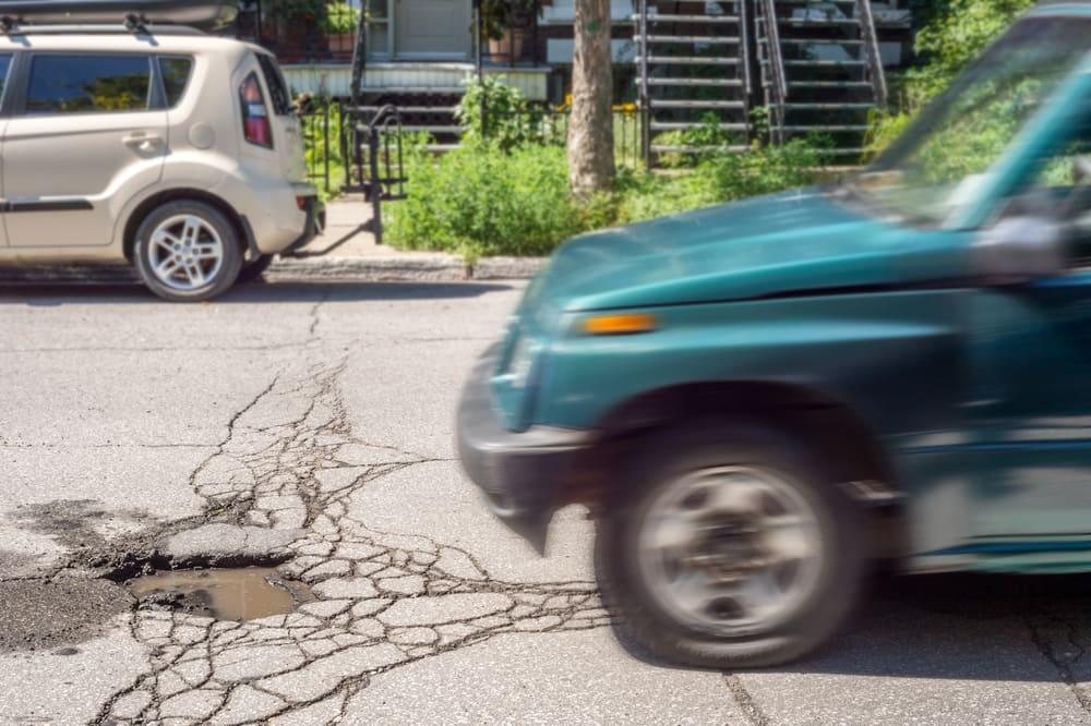 5 Car Parts Potholes Can Damage | YourMechanic Advice