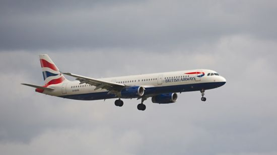 airlines British airways plane against grey clouds