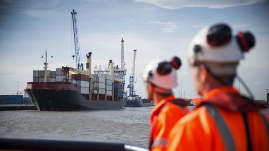 two men in hard hats by Port of hull,