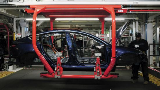 electric cars being built in factory