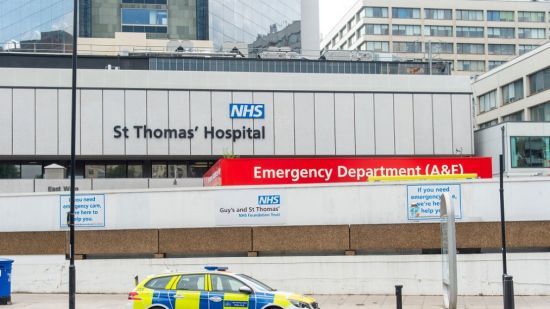 A police car parked outside the emergency department at St