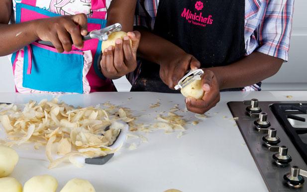 kids peeling vegetables